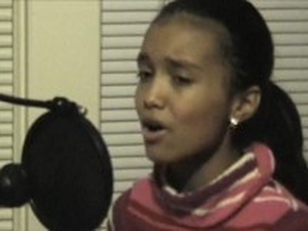 11 Year Old Girl Beautifully Sings Amazing Grace