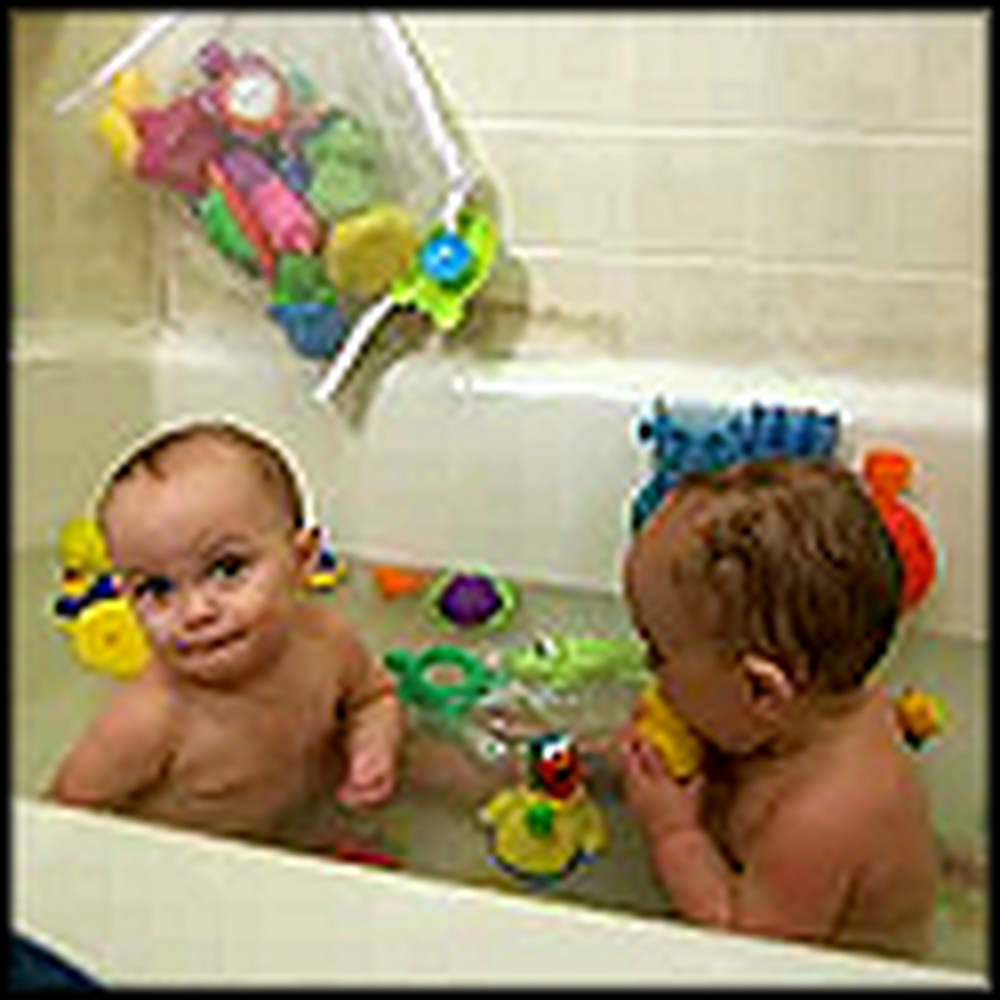 Adorable Twin Babies Giggle in the Bath Tub