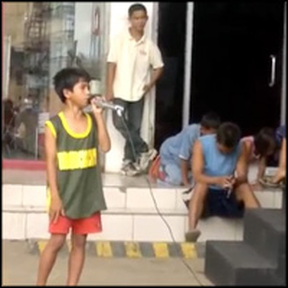 Poor Street Child Steps Up to a Karaoke Machine and Sings a Great Song