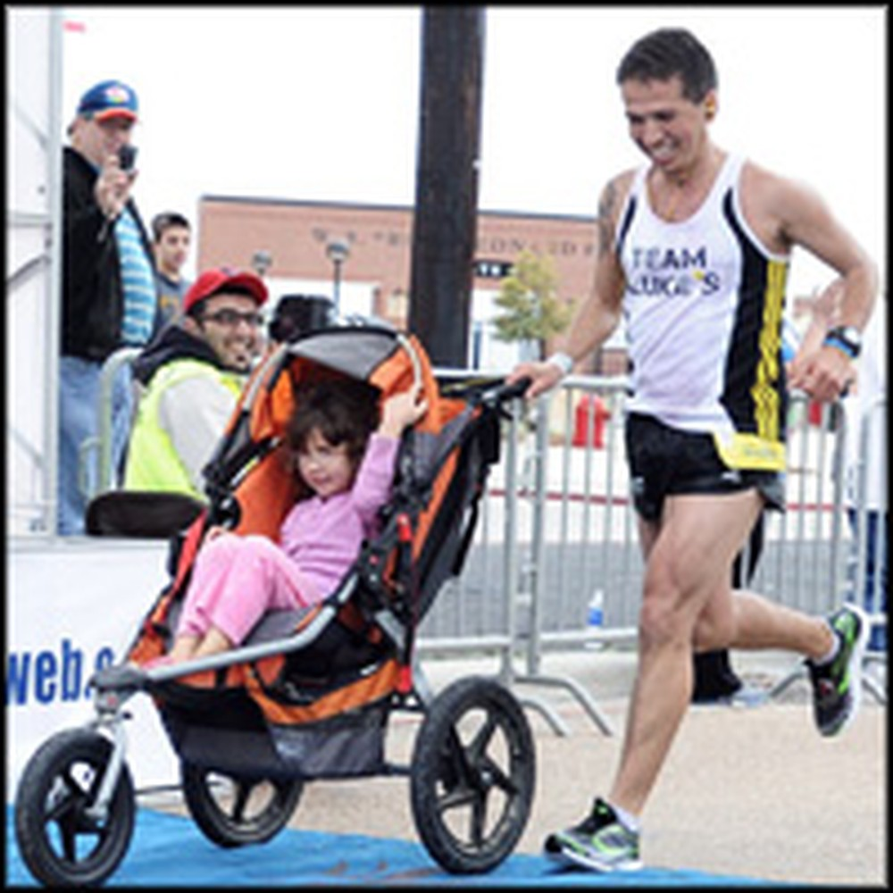 Brave Father with Brain Cancer Finishes First in a Marathon - Pushing His Daughter