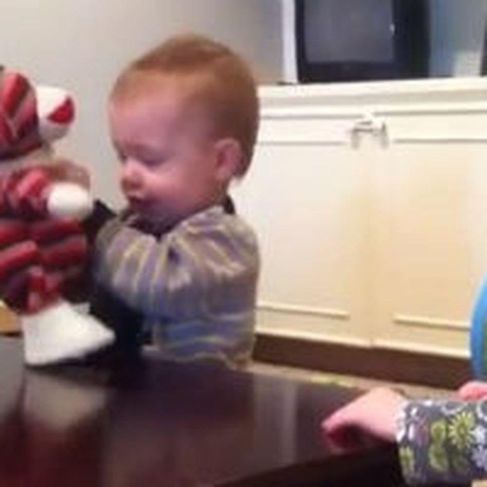 Twin Babies Dance With a Singing Toy Monkey
