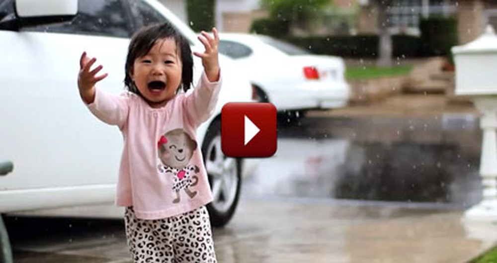Sweet Baby Experiences Rain for the Very First Time - and Supreme JOY
