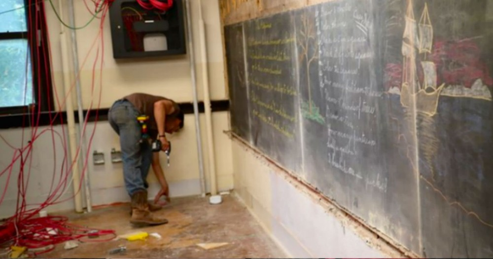 What He Uncovered Beneath This School's Chalkboards Will Amaze You!