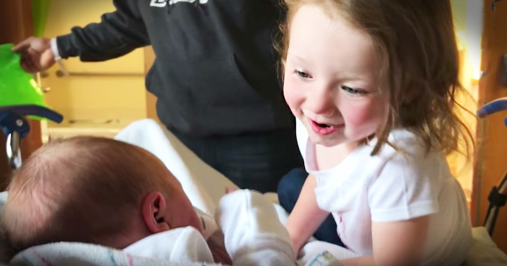 Toddler Meets Her Baby Sister For The First Time