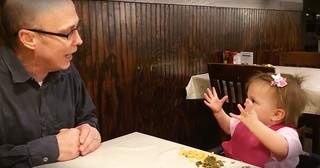 Babbling Baby Has Hilarious Argument At Dinner That No One Can Understand