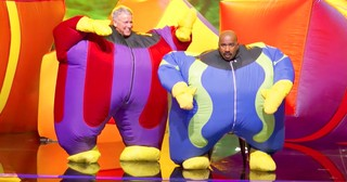 Inflatable Man And Steve Harvey Wow Crowd With Funny Moves