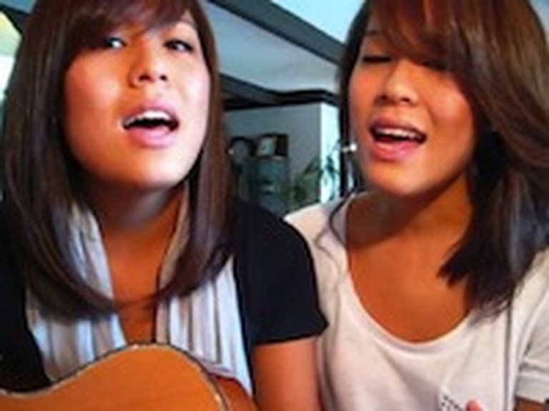 Two Girls Sing a Song for Their Late Grandmother