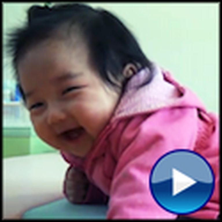 Super Adorable Baby Finds Tape Absolutely Hilarious