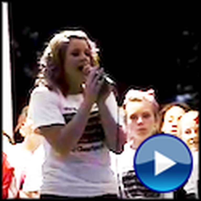 Christian Cheerleader Sings at a Rally Praising God