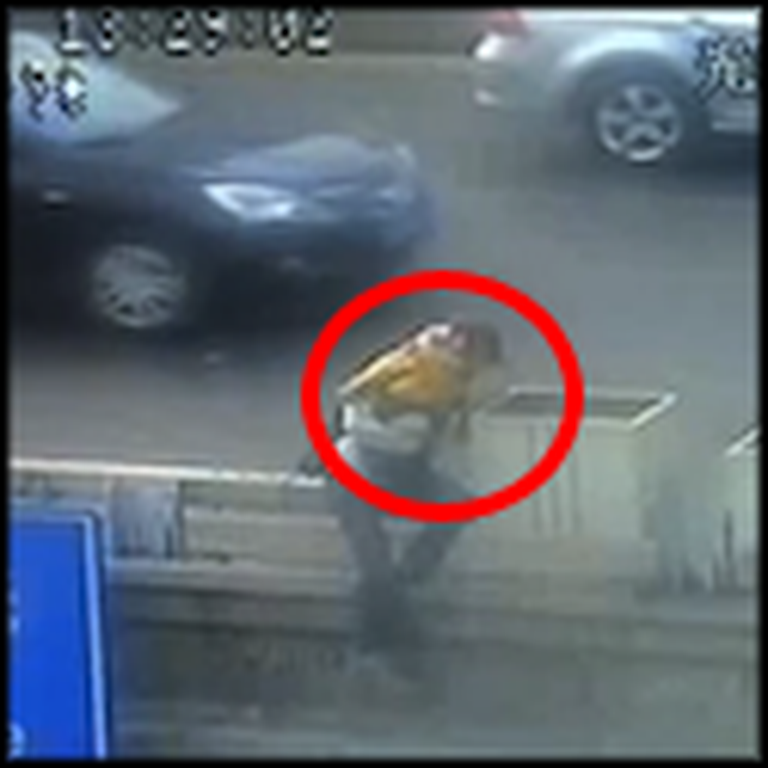 Policeman Stops a Suicidal Woman From Jumping Off a Bridge with her Baby