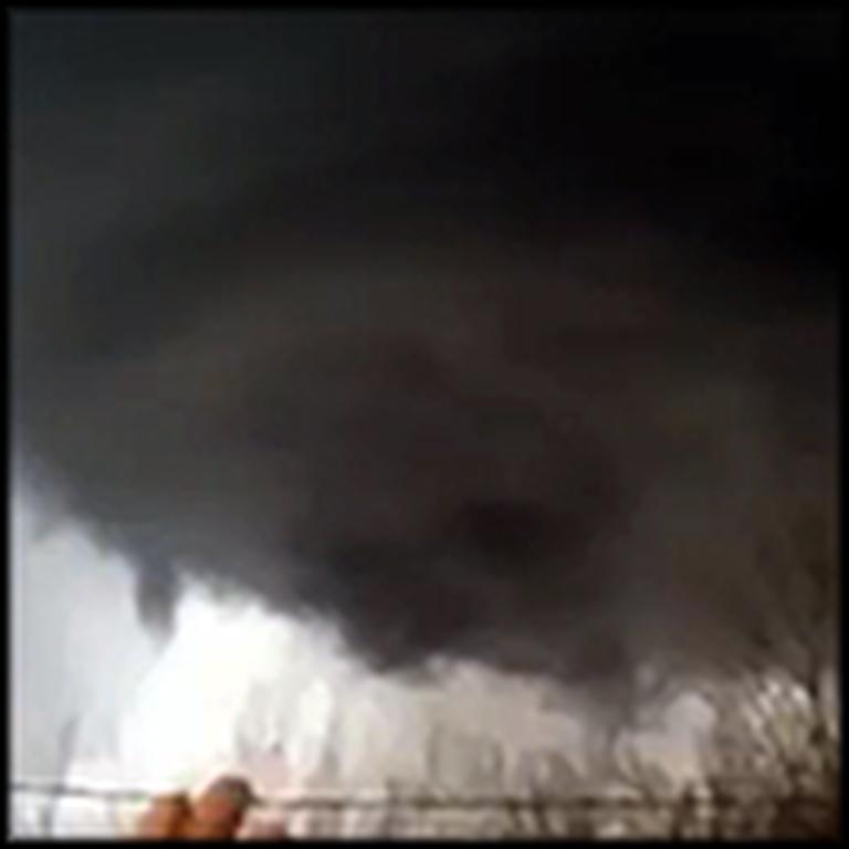 Woman Prays During a Vicious Tornado