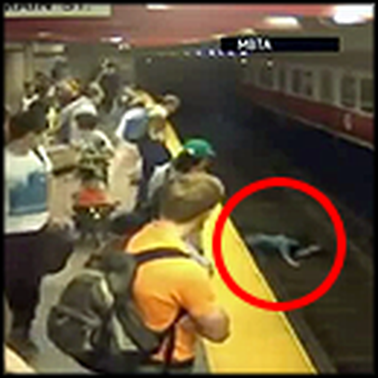 Woman and Child Fall on Train Tracks - But a Hero Saves the Day