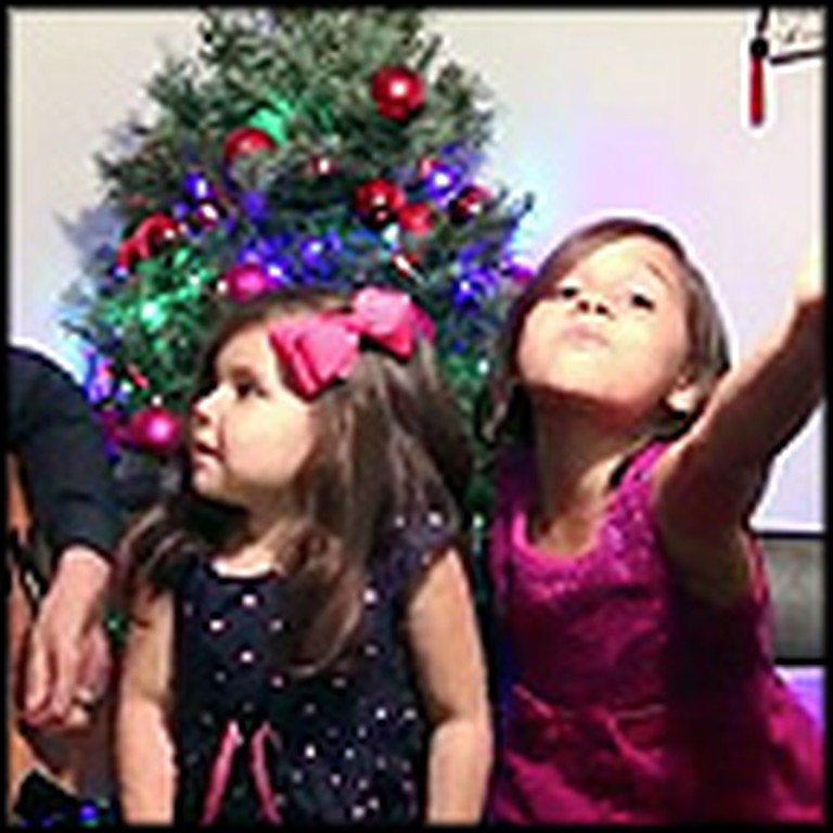 Father Sings Jingle Bells With His Two Adorable Daughters