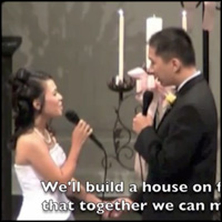 Bride and Groom Sweetly Sing Their Vows to Each Other