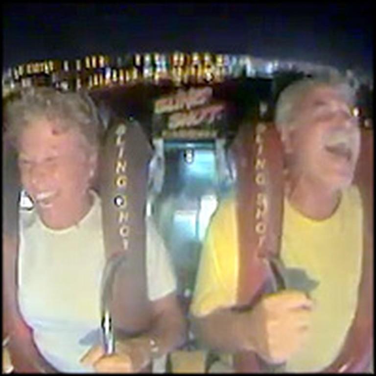 Older Couple Has a Blast on a Amusement Park Ride