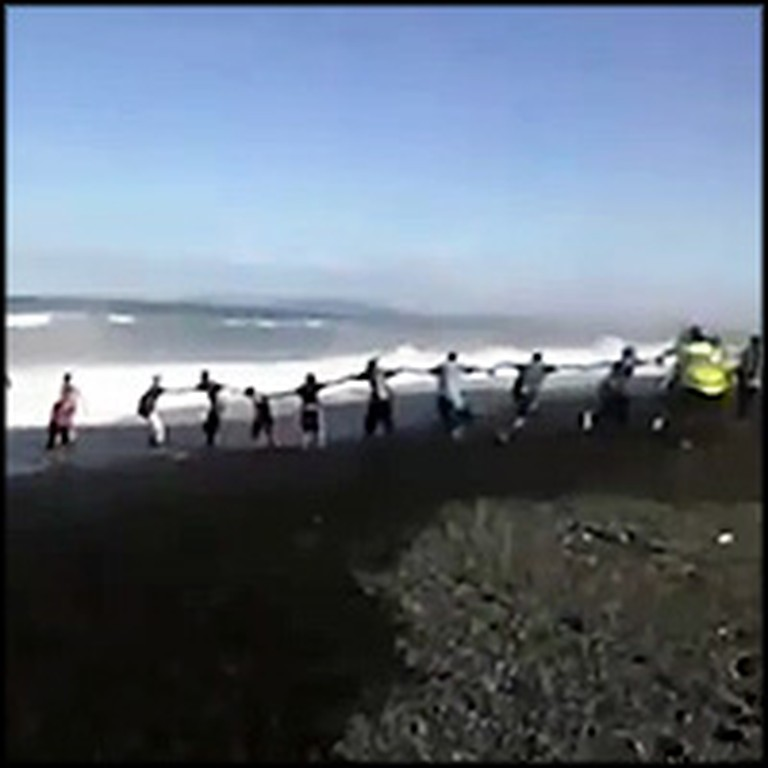 Beach-Goers Form a Human Chain to Save Drowning Boy