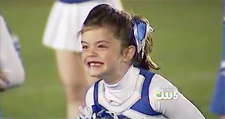 A 7 Year-Old Cheerleader is Overwhelmed with Joy When She Sees Her Sailor Daddy