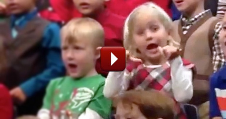 Little Girl Surprises Deaf Parents During Christmas Concert by Signing It for Them