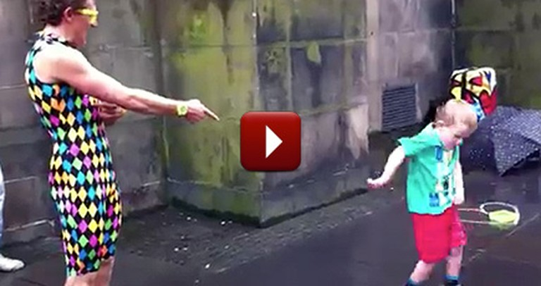 Hilarious Little Boy Steals the Spotlight From a Street Performer