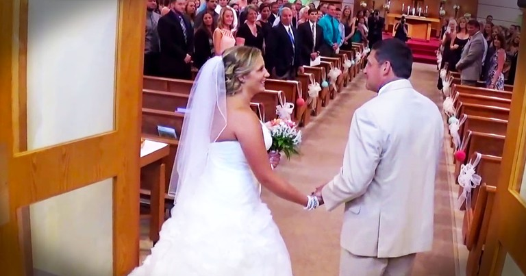 Father Sings To His Daughter As They Walk Down The Aisle