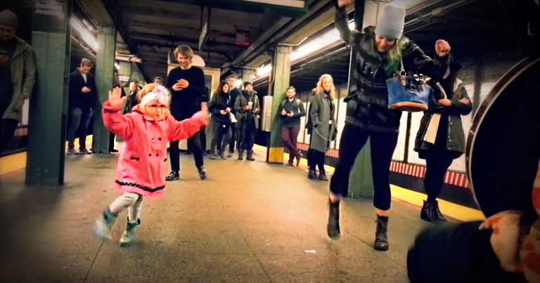 Adorable Girl Dances While Waiting For Train