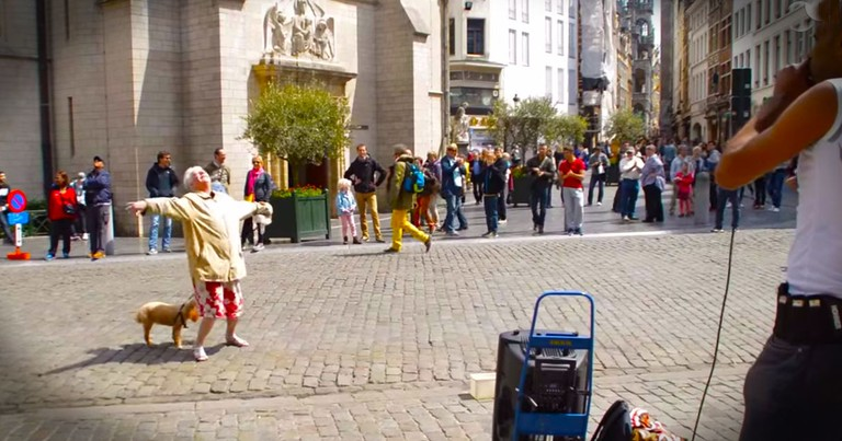 Apparently, This Granny Really Liked This Street Performer. . .And She's Got MOVES!
