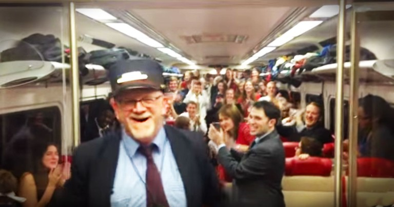 Train Conductors Turns Choir Conductor For Impromptu Christmas Performance