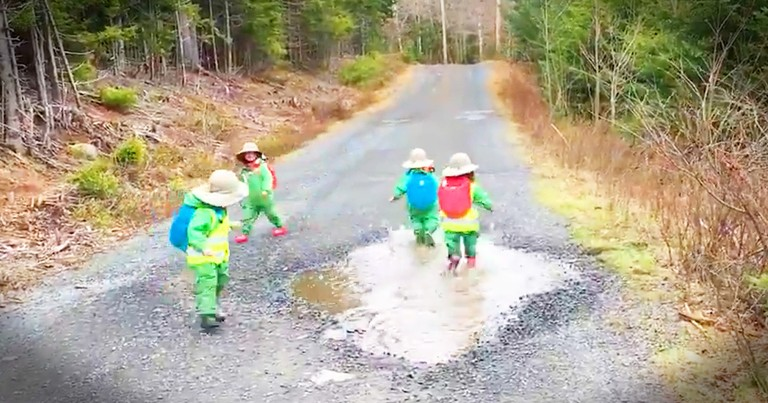 Tiny Kids And A Big Puddle Will Make Your Day