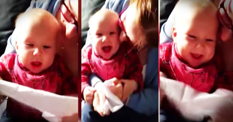 Just A Baby Hysterically Giggling At A Piece Of Paper
