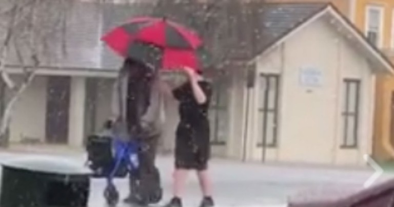 Teen Rushes To The Aid Of An Elderly Man Caught In A Sudden Hailstorm