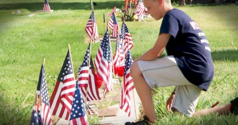 Patriotic Boy Puts Flags On Veteran's Graves
