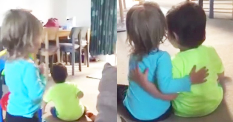 Little Girl Lovingly Consoles Her Sad Twin Brother