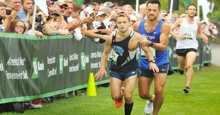 Competitor Helps Struggling Runner Cross Finish Line