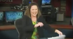 News Anchor Can't Stop Laughing At Swimming Cat
