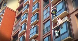 Firefighter Dramatically Rescues Suicidal Woman From The Side Of A Building