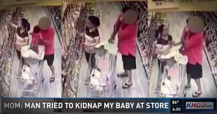 Video Footage Shows The Moment A Man Tried To Take A Baby With Her Mom Only Inches Away